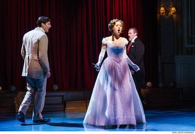 "The doggone girl is mine: Richard Collier (Andrew Samonsky) (left) and Robinson (Marc Kudisch) face off for the affections of Elise McKenna (Hannah Elless) in the new musical ""Somewhere in Time"" at Portland Center Stage."