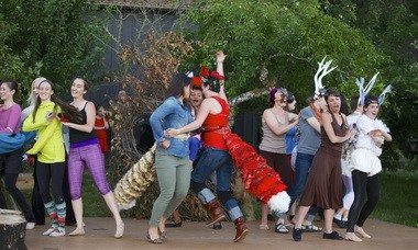 Forest creatures celebrate the uniting of Caitlin Mathes (center right), as Vixen Sharp Ears, and Rachel Hauge (center left), as Golden Mane the Fox.