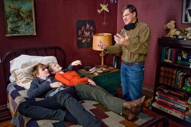 "Henry Hopper, left, and Mia Wasikowska listen to director Gus Van Sant on the set of ""Restless."""