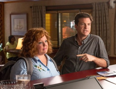 """This undated publicity image released by Universal Pictures shows Jason Bateman, right, and Melissa McCarthy in a scene from, """"Identity Thief."""""""