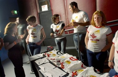 Fontaine Roberson, right, staffs the tee shirt table at the Bettie Ford Lounge during a fundraiser for local film maker Jackie Weissman. Weissman is working on a documentary called Rock N Roll Mamas.