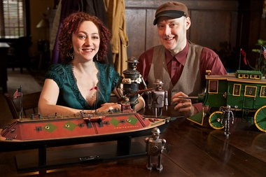 """Anina Bennett and Paul Guinan with models Guinan made for illustrations in the couple's book, """"Frank Reade: Adventures in the Age of Invention."""" The couple will be at the 10th anniversary Stumptown Comics Fest this weekend in Portland."""