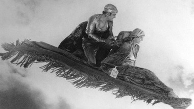 """Still of Douglas Fairbanks and Julanne Johnston in """"The Thief of Bagdad."""""""
