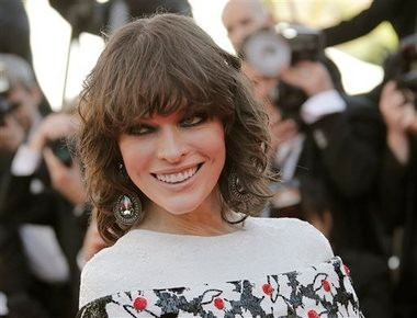 Milla Jovovich arrives for the screening of Blood Ties at the 66th international film festival, in Cannes, southern France. Swarovski is providing jewelry to stars such as Jovovich and the company is not concerned despite the high profile thefts during the festival.