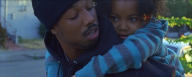 "Oscar Grant (Michael B. Jordan) carries his young daughter Tatiana (Ariana Neal) in a scene from the film ""Fruitvale Station."""