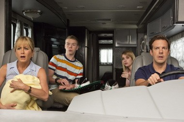 "This film image released by Warner Bros. Entertainment shows, from left, Jennifer Aniston, Will Poulter, Emma Roberts, and Jason Sudeikis in a scene from ""We're the Millers."""