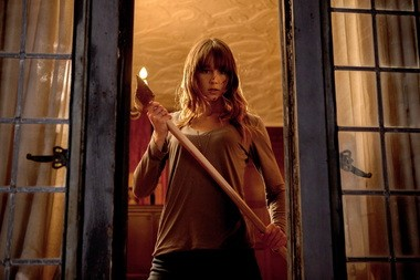 "This film publicity image released by Lionsgate shows Sharni Vinson in a scene from ""You're Next."""