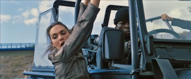"Gal Gadot hangs on for dear life in a scene from ""Fast & Furious 6."""