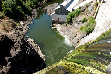FILE - This Aug. 21, 2009 filephoto shows water trickling over Copco 1 Dam on the Klamath River outside Hornbrook, Calif.