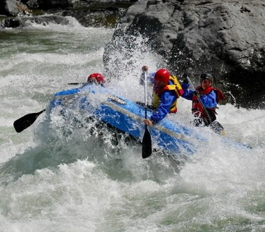 Rafters ride the spring melt of the Cascades through Boulder Drop, a Class 4-plus rapid, on the Skykomish River near Index, Wash.