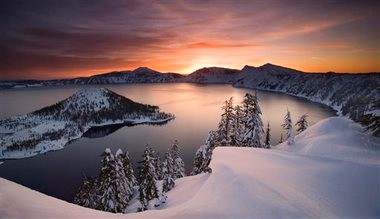 The sun rises over Crater Lake, Ore., in January 2006. Crater Lake National Park surrounds the deepest lake in the United States, and may soon have insufficient water supplies for its public operations. State water regulations in the Klamath Basin have begun shutting off farmersâ and ranchersâ water for the first time â and could extend shutoffs to public lands including Crater Lake.