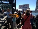 Lorie and Wilbur Wood, both in their 80s, are long-time peace activities who joined protestors on the Interstate-5 bridge to fight the export of fossil fuels.