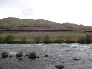 A reader saw this oil train moving along the Deschutes River on April 17. Though oil trains have introduced the risks of catastrophic spills along the river and others, planning has lagged.