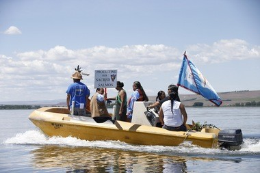 Yakama Nation members protest on the Columbia River near the site of a proposed coal terminal at the Port or Morrow in Boardman, Ore., on May 20. Tribal groups say the terminal would interfere with treaty rights, harm fish and put their health at risk. Tribal groups say the terminal would interfere with treaty rights, harm fish and put their health at risk. Thomas Boyd/The Oregonian