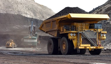 FILE - In this April 4, 2013 file photo, a truck carrying 250 tons of coal hauls the fuel to the surface of the Cloud Peak Energy's Spring Creek mine near Decker, Mont. (AP Photo/Matthew Brown, File)