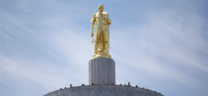 The Oregon Pioneer statue on the State Capitol in Salem.