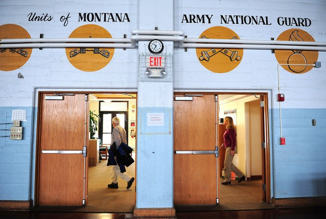 Montana Department of Environmental Quality employees scramble to gather personal belongings and exit the former Helena, Montana, armory after an immediate closure of the building in 2013. Elevated levels of lead were determined to be in the workspace.