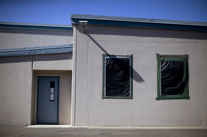 Baffles on the back side of the Coos Bay, Oregon armory are covered with heavy plastic and sealed with duct tape to keep lead from escaping. The armory is closed to the public but still retains staffing that rotates into the building about once a month.
