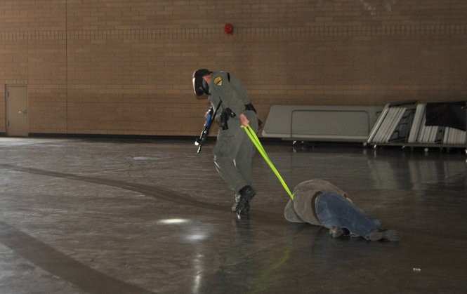 Simulated victims are dragged through the Forest Grove armory during an active shooter drill in April 2014, leaving trails on the dusty drill hall floor. An inspection three months later found the floor was contaminated with lead.