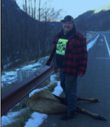 Joseph Dills poses with a poached animal in Washington, according to state investigators.