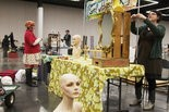 Vendors at work setting up their booths for the Crafty Wonderland Super Colossal Sale at the Oregon Convention Center, in a 2011 photo.