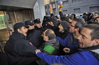 Police confront demonstrators during a general strike last month in Pamplona, Spain. Protestors decried austerity measures and the country's financial crisis, which is impacting its bond ratings.