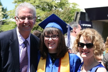 Taylor Stanton, with her parents Scott and Robin Stanton, after her graduation from St. Mary's Academy in Portland.