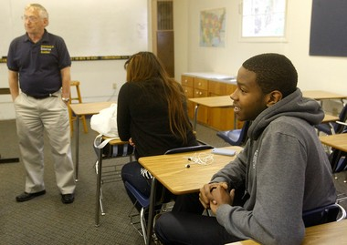 Canyonville Christian Academy junior Julian Gakwaya (right) looks on during class taught by Roger Shaffer on May 15, 2013.
