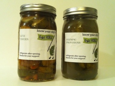 Lutz Tavern's winning entry in the Perfect Pickle competition, along with the runner-up cukes from Olympic Provisions.