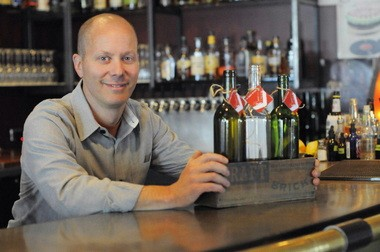 Thanks to a new law, Scott Dolich's Bent Brick tavern can sell wine in growlers or in the repurposed wine bottles that Dolich offers.Sunny Strader/The Oregonian