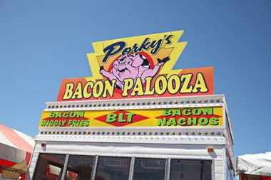 Aaron Ail's bacon stand, Porky's Bacon Palooza, is new to the Oregon State Fair this year and has a pork-centric menu that includes BLTs, bacon nachos and chocolate-dipped bacon.