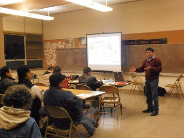 Alejandro Tecum, director of the Adelante Agricultura program, explains the components of fertile soil during the Jan. 21 Spanish-language sustainable farming class.