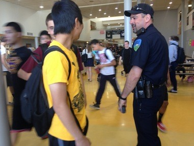 Forest Grove officer Tom Siciliano walks through the cafeteria during lunch time to check in with students on a variety of topics, from problems at home to in-school assignments.