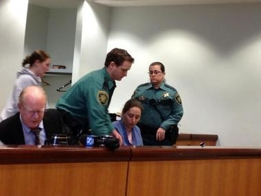 Multnomah County Sheriff's deputies assist Chandra Rose after she pleads guilty to manslaughter in Multnomah County Circuit Court on Friday.