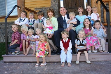 Vivienne Lewis, named Oregon's Mother of the Year for 2013, and her husband Crismon (center) posed with 17 of their grandchildren last year. Two other children were down for naps, and another two have been born since this photograph was taken.