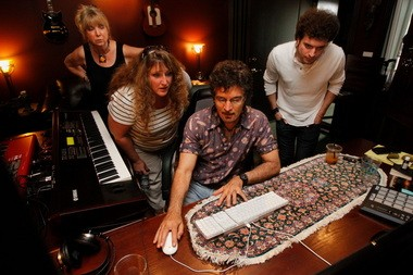 Gino Vannelli with his class this month (from left): Phyllis Thiemann of Corbett, Paula Mitchell of the United Kingdom, Vannelli, and Jamie Alimorad of New York watch the audio editing during their class.