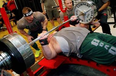 Powerlifter Adrian Larsen will try to outdo Ireland resident Eamonn Keane's record for the heaviest bench press in one minute.