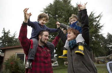 Kelvin Gurr hoists his son, Canyon, 5, while his wife, Audrianna, gives 3-year-old Oakley a lift.