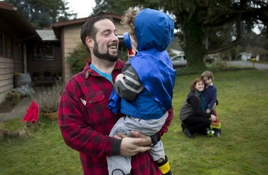 Kelvin Gurr with Oakley, 3, at home in Northeast Portland.