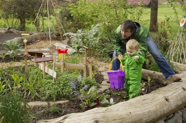 Carl Grimm enjoy's Blue Lake Park's Natural Discovery Garden with his son, Elouan.