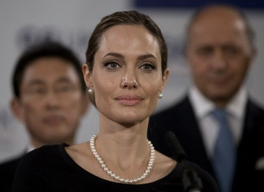 Actress Angelina Jolie, in her role as U.N. envoy, talks during a news conference regarding sexual violence against women in conflict, during the G8 Foreign Ministers meeting in London, Thursday, April, 11, 2013.