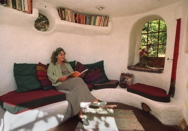 This 2000 photo shows Linda Smiley in the cob house she and her husband built near Cottage Grove. She's a director of the Cob Cottage Co., which researches and teaches cob construction.