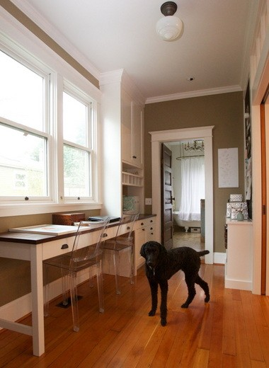 The home reconfiguring left created space for a narrow office in the hallway.