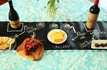 Chalkboard on the table adds informality and keeps guests of all ages entertained.