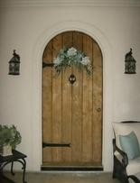 Sue Webb has a heavy custom door that fronts her Tuscan-style house in Eagle Point.