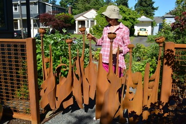 Virginia Malone with her beautiful new gates.