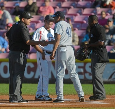 Hillsboro manager Audo Vicente shakes the hand of an umpire before the Hops' season opener at Salem-Keizer. The addition of Hillsboro gives Oregon three of the eight teams in the Northwest League.
