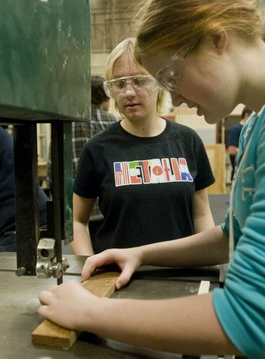 Hannah Fritsch (right) and Carolynn Dulaney, both Glencoe High freshmen, make a spacer for the flying disc shooter on clubâÂÂÂÂs robot this week. They are two of four girls on the 24-member Glencoe robotics team.