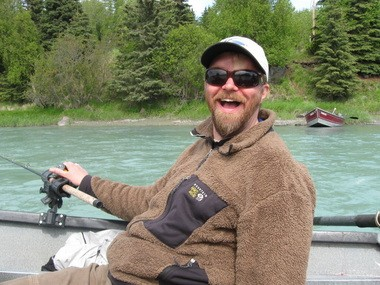 Dan Bigley, king fishing on the Kasilof River in Alaska. Permanently blinded by a grizzly bear attack in 2003, he has now returned to the outdoor activities he loves, including fishing and wading down the Alaskan rivers.