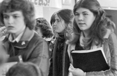 """Six years after her own graduation from high school, Debra McKinney (center) navigates the hallways of Hillsboro High School as an """"undercover student"""" and staff writer for the Hillsboro Argus. Her article was published in the Dec. 11, 1980, issue."""
